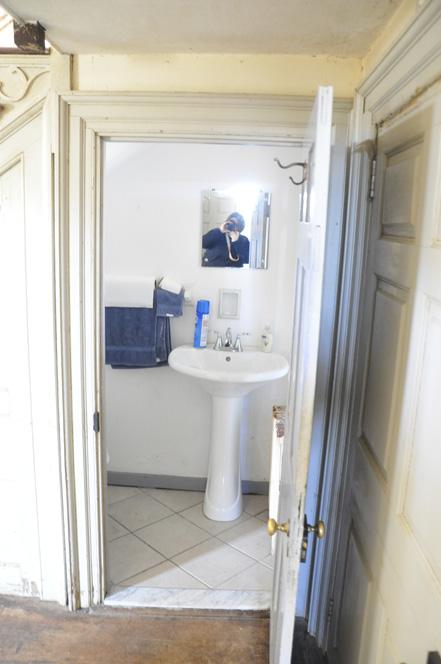 downstairs half bath under stairs